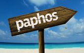 Paphos wooden sign with a beach on background