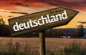 Deutschland wooden sign in a rural background
