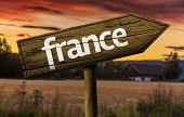 France wooden sign in a rural background