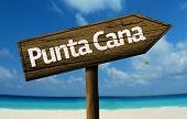 Punta Cana, Dominic Republic wooden sign with a beach on background