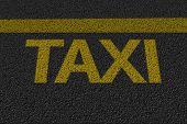 Taxi sign on the asphalt
