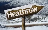 Heathrow wooden sign with a snow background