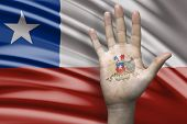 Amazing composition with a Hand with the Coat of Arms of Chile and the Chilean flag as the background