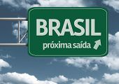 Brasil, proxima saida (next exit) creative road sign and clouds