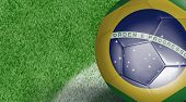 Amazing Soccer ball with Brazil flag isolated on field