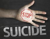 stock photo of suicide  - Educational and Creative composition with the message Stop Suicide on the blackboard - JPG