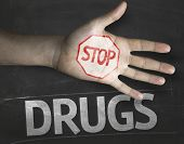 Educational and Creative composition with the message Stop Drugs on the blackboard