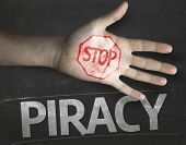 Educational and Creative composition with the message Stop Piracy on the blackboard