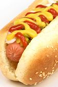 stock photo of hot dog  - hot dog against white background with onions picklesketchup and mustard on top - JPG