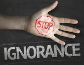 Educational and Creative composition with the message Stop Ignorance on the blackboard