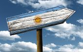 Argentina flag wooden sign with a beautiful sky on background - Latin America