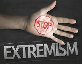 Educational and Creative composition with the message Stop Extremism on the blackboard