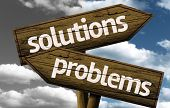 Solutions x Problems creative sign with clouds as the background