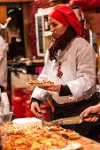 BUDAPEST, HUNGARY - DEC 03: Unidentified woman serves food in the Budapest Christmas Fair on Dec. 03, 2012 in Budapest. Budapest Christmas Fair is one of the most popular Christmas markets in Europe.