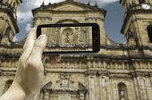 Hand takes a picture of the Bogota Cathedral, Colombia - South America
