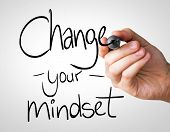 Change your Mindset hand writing with a black mark on a transparent board