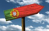 Portugal flag wooden sign with a beautiful sky on background - Europe