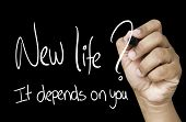 New Life, it depends on you Hand writing with white marker on transparent wipe board