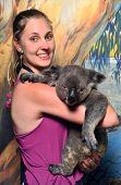 Female holding Koala in Australia
