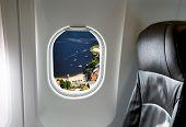 Bay through aircraft window onto jet engine