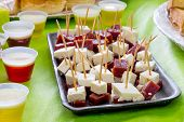 stock photo of reveillon  - Colorful table with many delicious for the kids - JPG