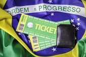 Homemade brazilian tickets 2014 on the brazilian flag on the background