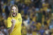 Brazilian woman celebrates on the arena background