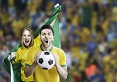 Brazilian couple celebrate on the stadium