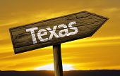 Texas wooden sign on a beautiful day