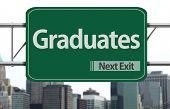 Graduates road sign on the city