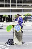 SAO PAULO, BRAZIL - CIRCA JAN 14 - Elvis Presley cover performes on Paulista Avenue in Sao Paulo, Brazil.