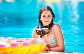 Portrait of happy beautiful teen girl at the pool smiling and looking at camera .Teen girl
