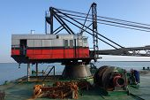 pic of boom-truck  - Old red and gray crane on tanker boat - JPG
