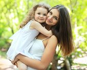 image of family bonding  - Portrait lovely mom and daughter in warm sunny summer day happy family - JPG