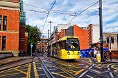 Metrolink tram runs along Manchester street