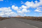 Road Through Lava Rocks And Volcanic Mountains. Los Hervideros. Lanzarote
