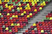 stock photo of tribunal  - Detail with empty colored sports arena tribune on a football stadium - JPG