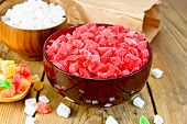 Candied fruit colored in bowl and spoon on board