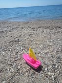 The pink toy boat