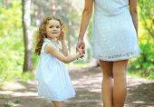 Cute Curly Girl Walking With Mom