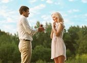 pic of propose  - Love relationship couple wedding romantic man proposing to a woman in the park - JPG