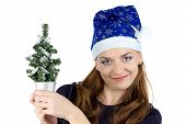 Photo of woman with small christmas tree