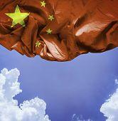 China waving flag on a beautiful day