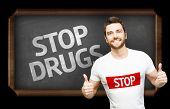 Campaign against Drugs by a man on blackboard background