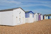 picture of beach hut  - A row of traditional British beach huts on the pebble beach at Glyne Gap between Hastings and Bexhill - JPG