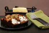 stock photo of fresh slice bread  - Freshly baked and sliced banana bread with butter - JPG