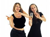 stock photo of office party  - Two girls in black formal wear dancing with champagne glasses  - JPG