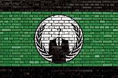 stock photo of anonymous  - flag of Anonymous painted on brick wall - JPG