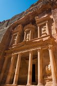 image of treasury  - The Treasury of the Pharaoh building carved into the rock face at Petra in Jordan - JPG