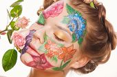 picture of blue rose  - Spring portrait of woman model with hand drawing flowers on her face - JPG